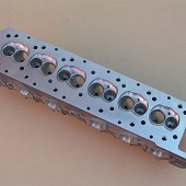 V12 JAGUAR CYLINDER HEAD MACHINED CASTING.